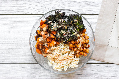 Overhead shot of the roasted sweet potato and broccoli rice bowl with a beige napkin.