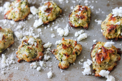 another angle of the zucchini tots with feta cheese on a baking tray