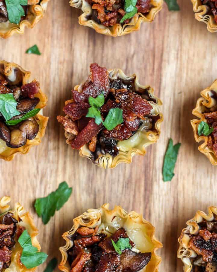 My favorite part about this recipe isn't the Brie, not the bacon, and it's actually not the phyllo cups. It's these gorgeous sauteed mushrooms! Sliced really thin, these saute in oil until slightly crispy and really robust in flavor. Sprinkled with a little bit of salt, they are the perfect companion to the Brie and crispy bacon.