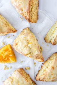 Overhead shot of the orange scones on wax paper.