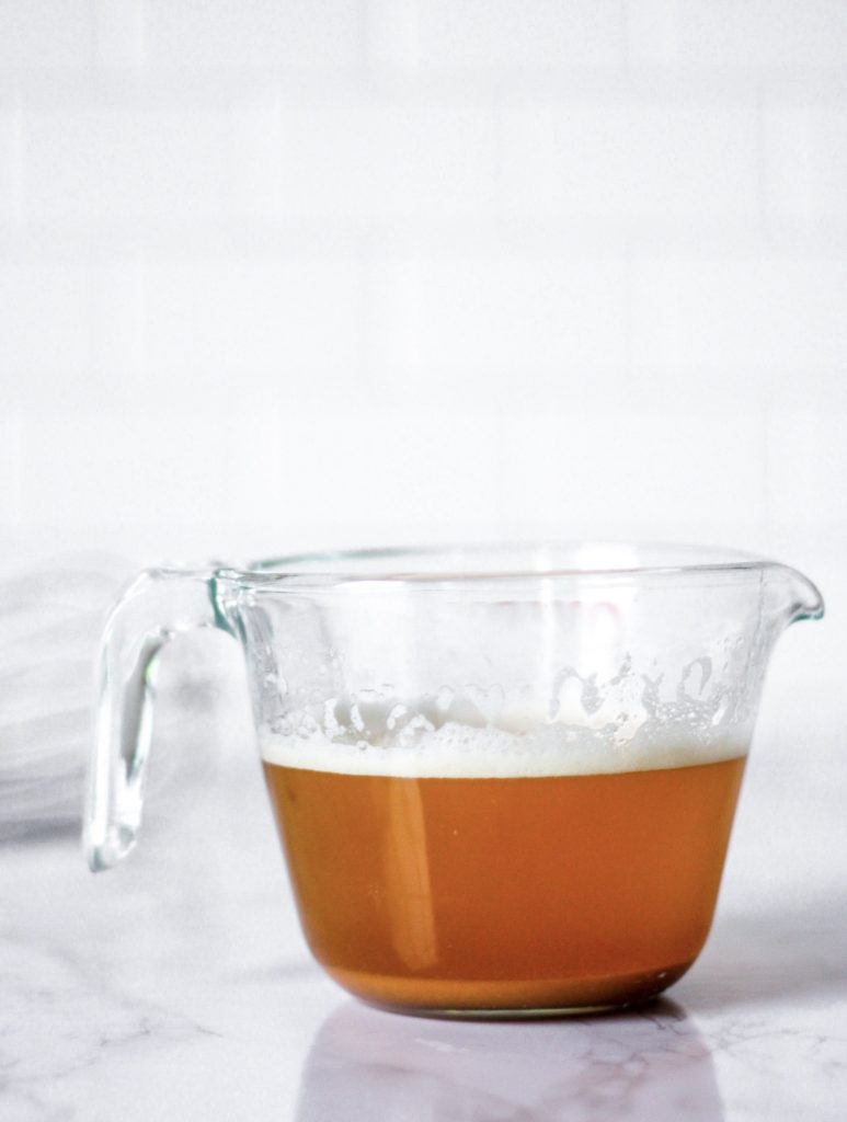 a glass measuring cup of brown butter