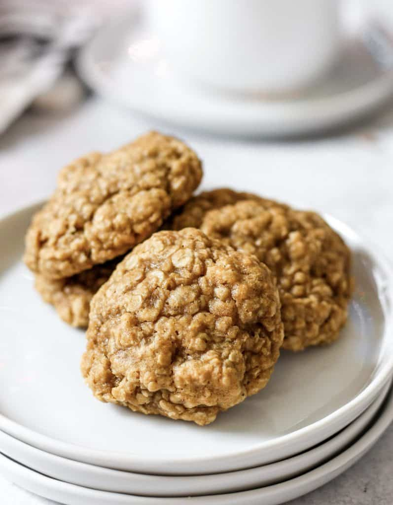 brown butter oatmeal cookies on a stack of 3 white plates.