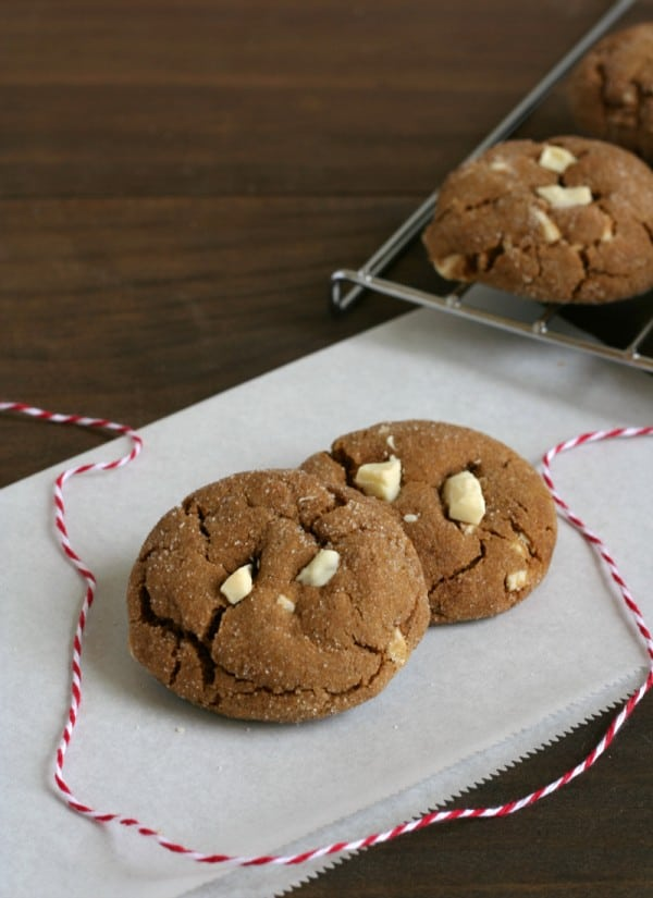 cookies on parchment paper with red and white bakery string.