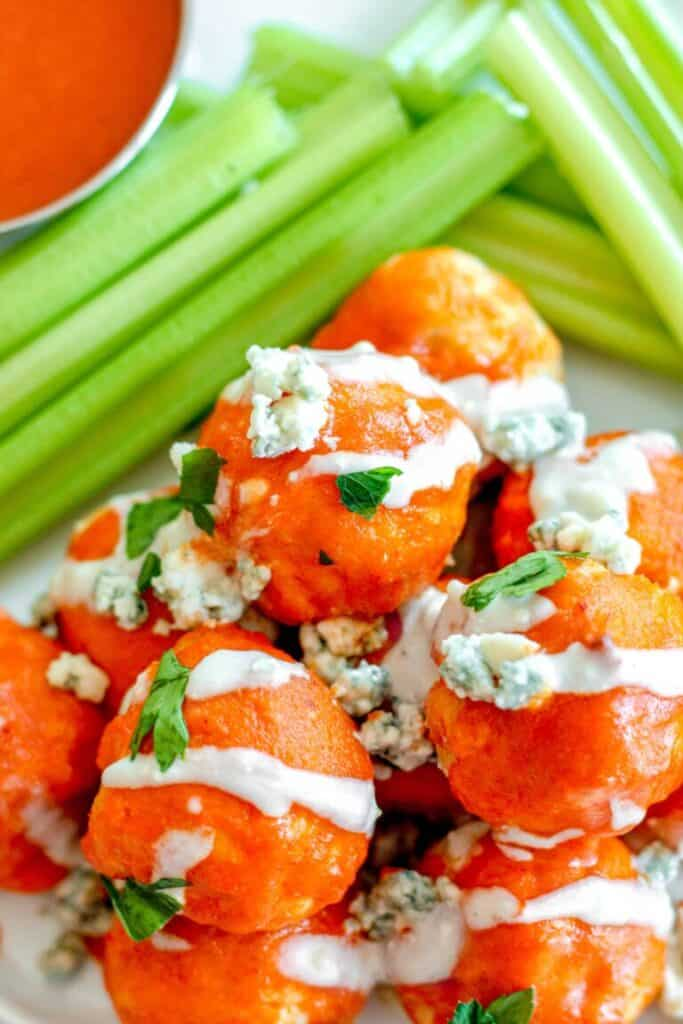 buffalo chicken meatballs with crumbled blue cheese and celery.