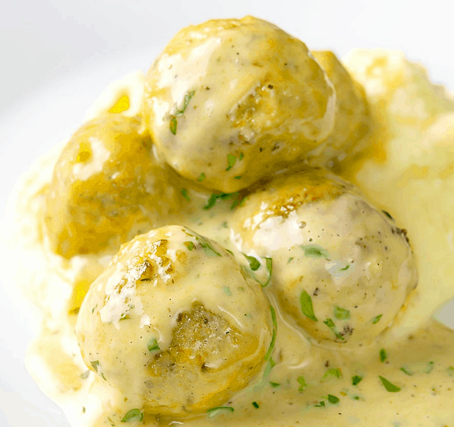 a pile of the chicken meatballs in a honey mustard sauce.