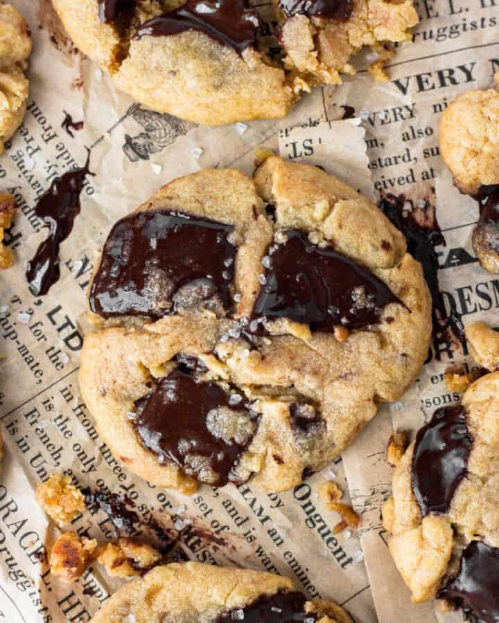 chocolate chunk cookies on brown newsprint paper