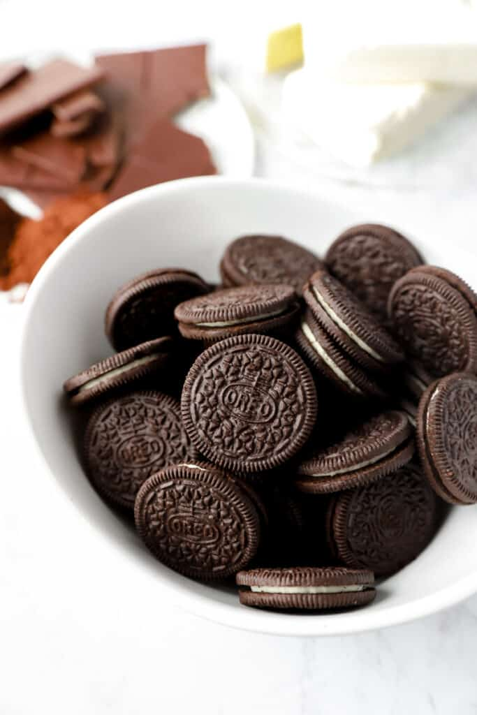 close shot of a bowl of Oreos. Other ingredients in the back.