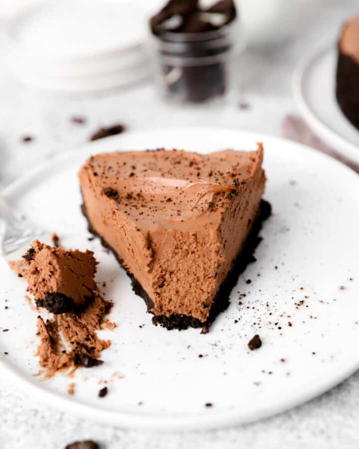 slice of no bake chocolate cheesecake on a white plate