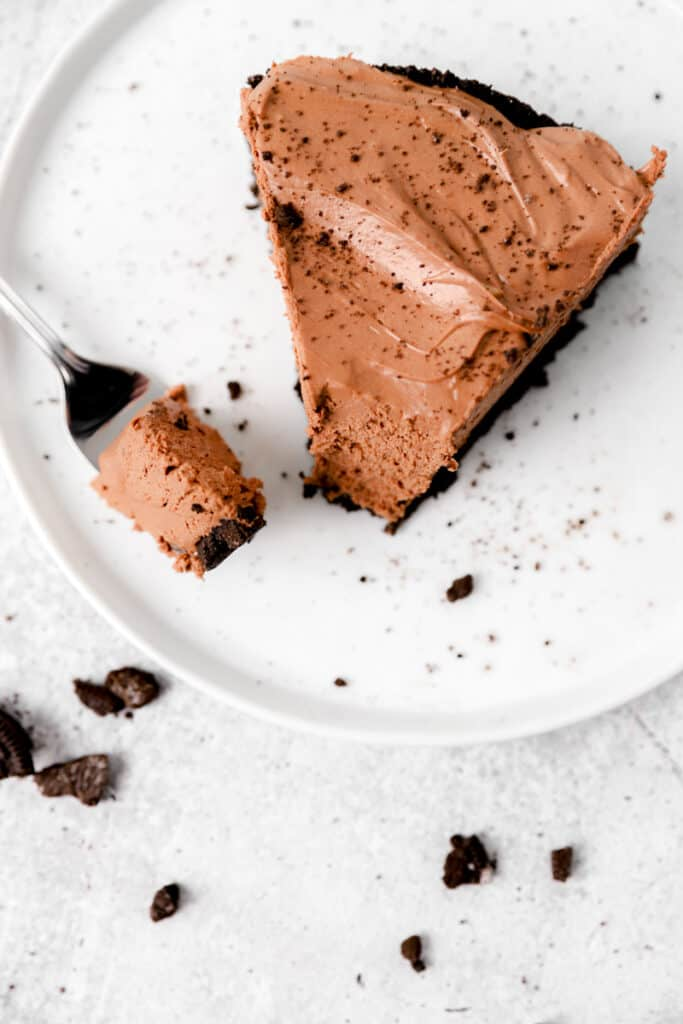 over head shot of a slice of the no bake chocolate cheesecake with a fork.