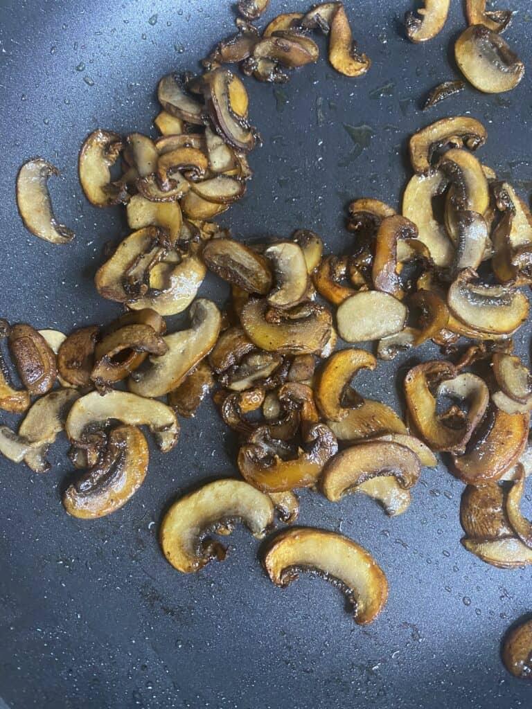 the sauteed mushrooms in the black pan.