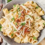 overhead shot of the creamy Cajun chicken pasta in a grey bowl.