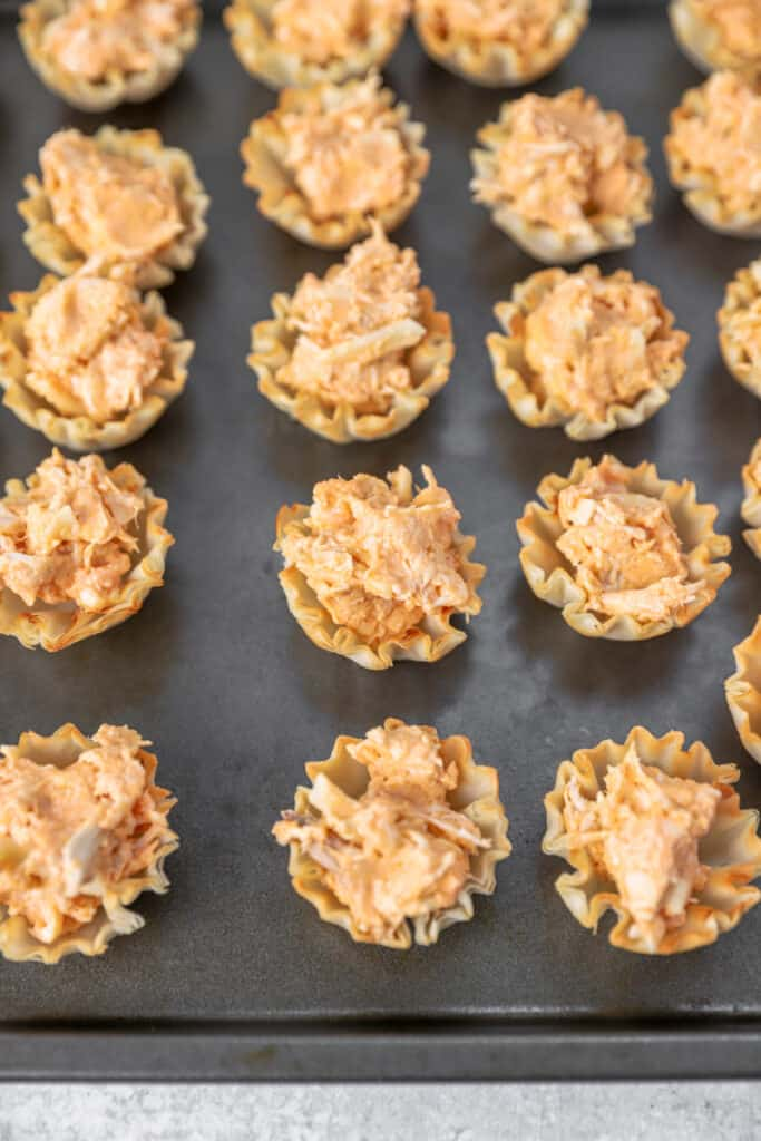 the filled phyllo cups on the baking sheet before baking them.