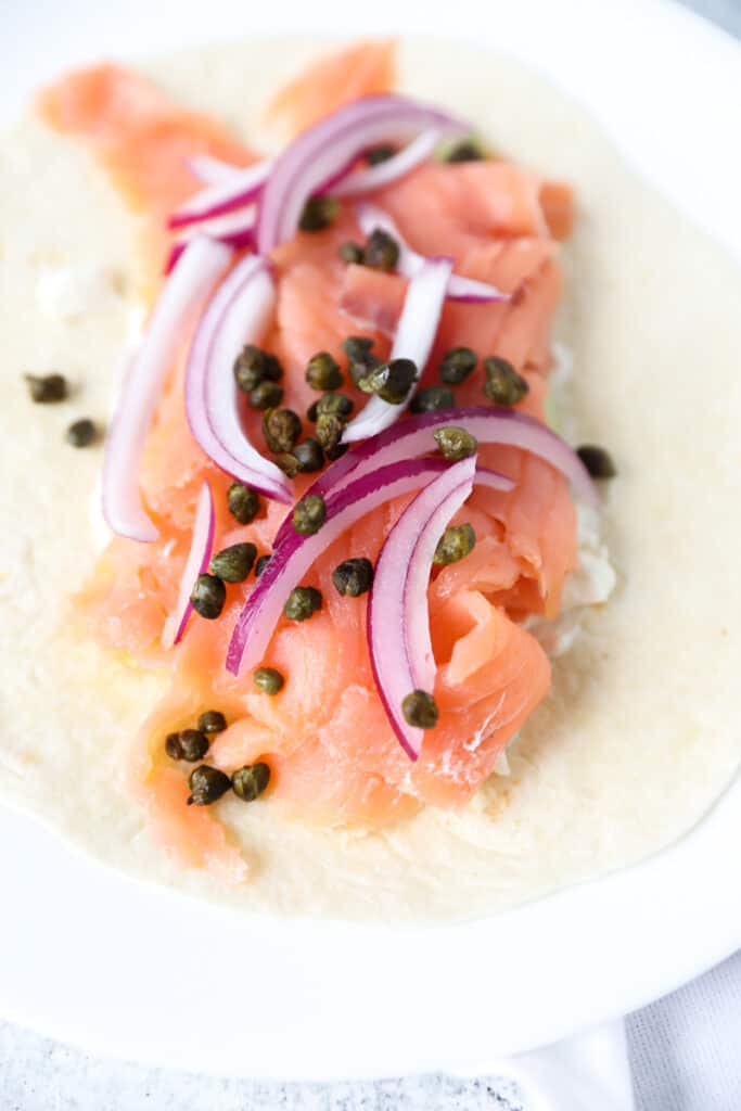 smoked salmon wrap topped with fried capers and red onions.