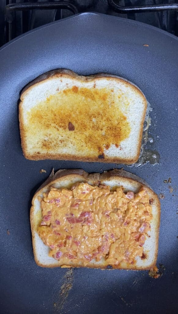 overhead shot of the grilled cheese being made in a large pan.