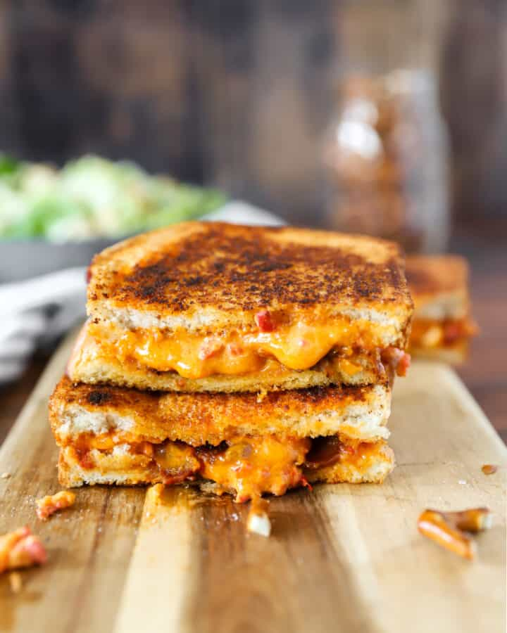 pimento grilled cheese on a wood cutting board